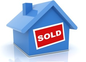 blue house with red SOLD sign