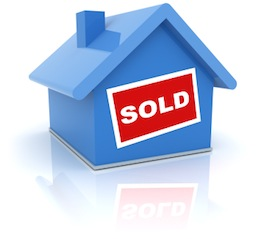 "Graphic of blue house with red ""SOLD"" sign on the front"